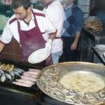 Grilling fish and deep frying hamsi (anchovies)
