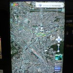 Large touch-screen local area (satellite) map and info at a metro station