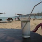 Refreshing drink in the shade on the beach