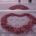 2 hearts from raked leaves in courtyard of N Seoul Tower