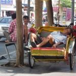 Sleeping ricksaw driver