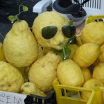 Lemons with sunglasses at a roadside fruit stand near Positano