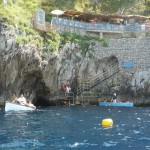 Entrance to the Blue Grotto (the little black hole to the right of the white rowboat)
