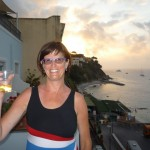 Enjoying wine and cheese on our balcony, looking west at the sunset